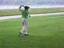 Darin Fisher playing golf.