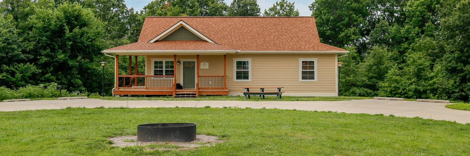 Cute private cottages at Honey Creek Resort with a covered deck and picnic table