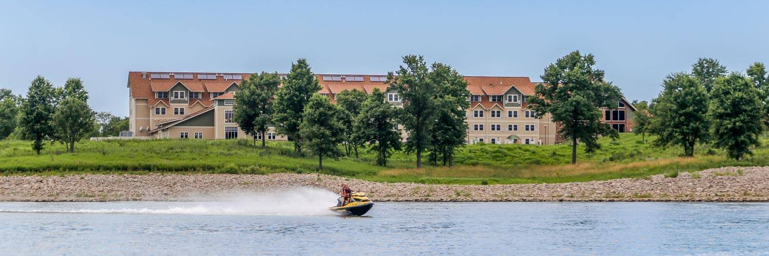 Jet skiing on Rathbun Lake in front of Honey Creek Resort