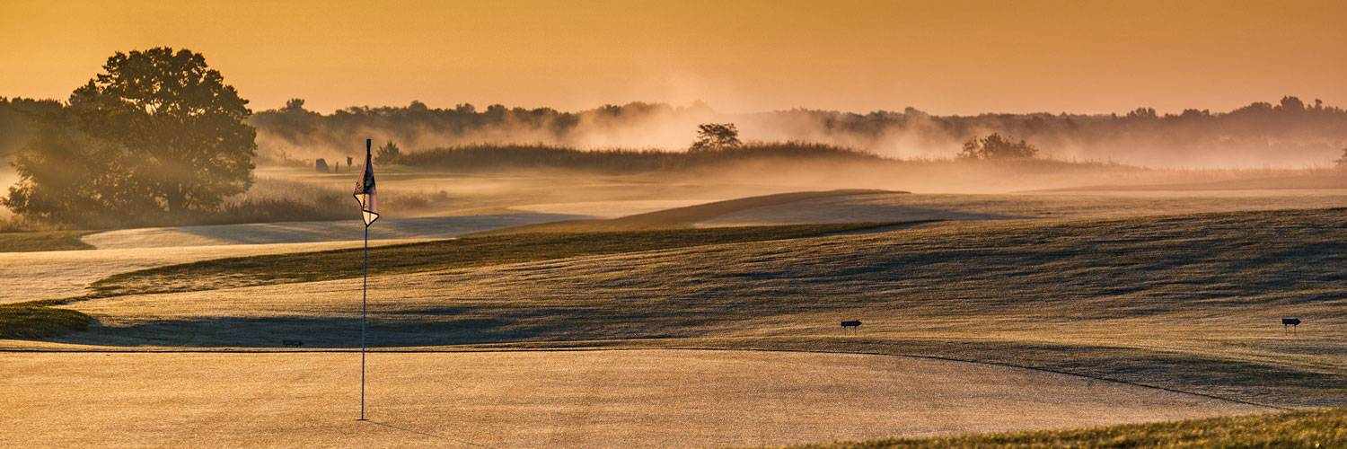 Golden morning light on a golf green at The Preserve on Rathbun Lake at Honey Creek Resort
