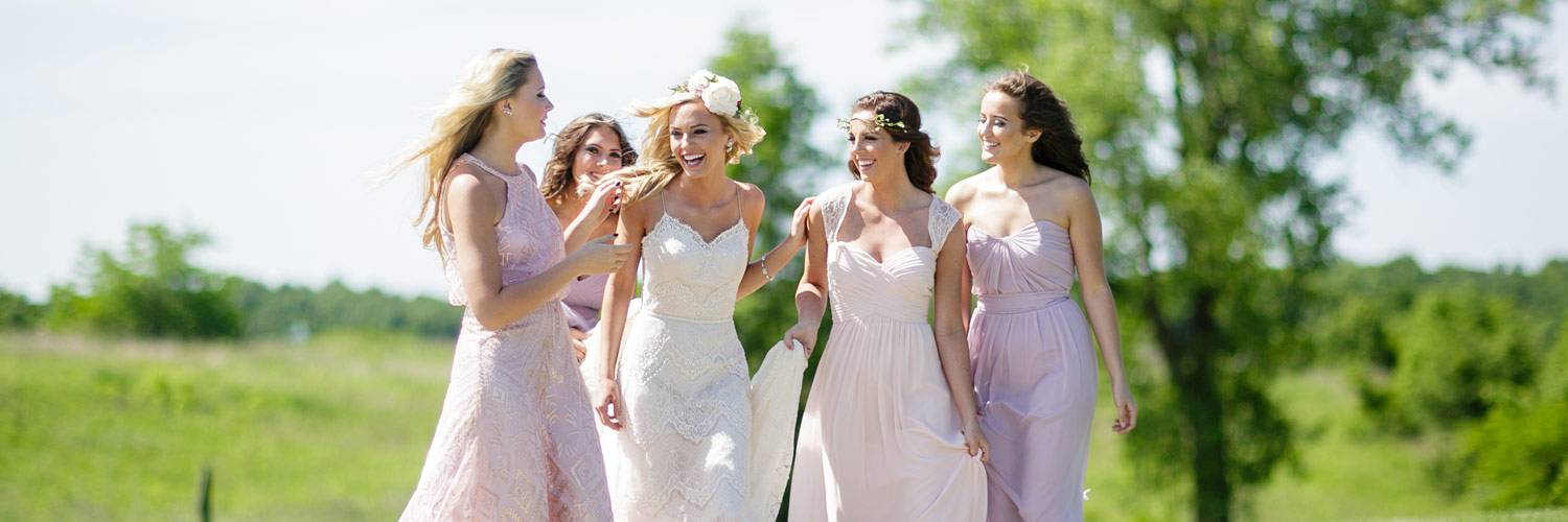 Bride and bridesmaids having fun together before the wedding ceremony at Honey Creek Resort