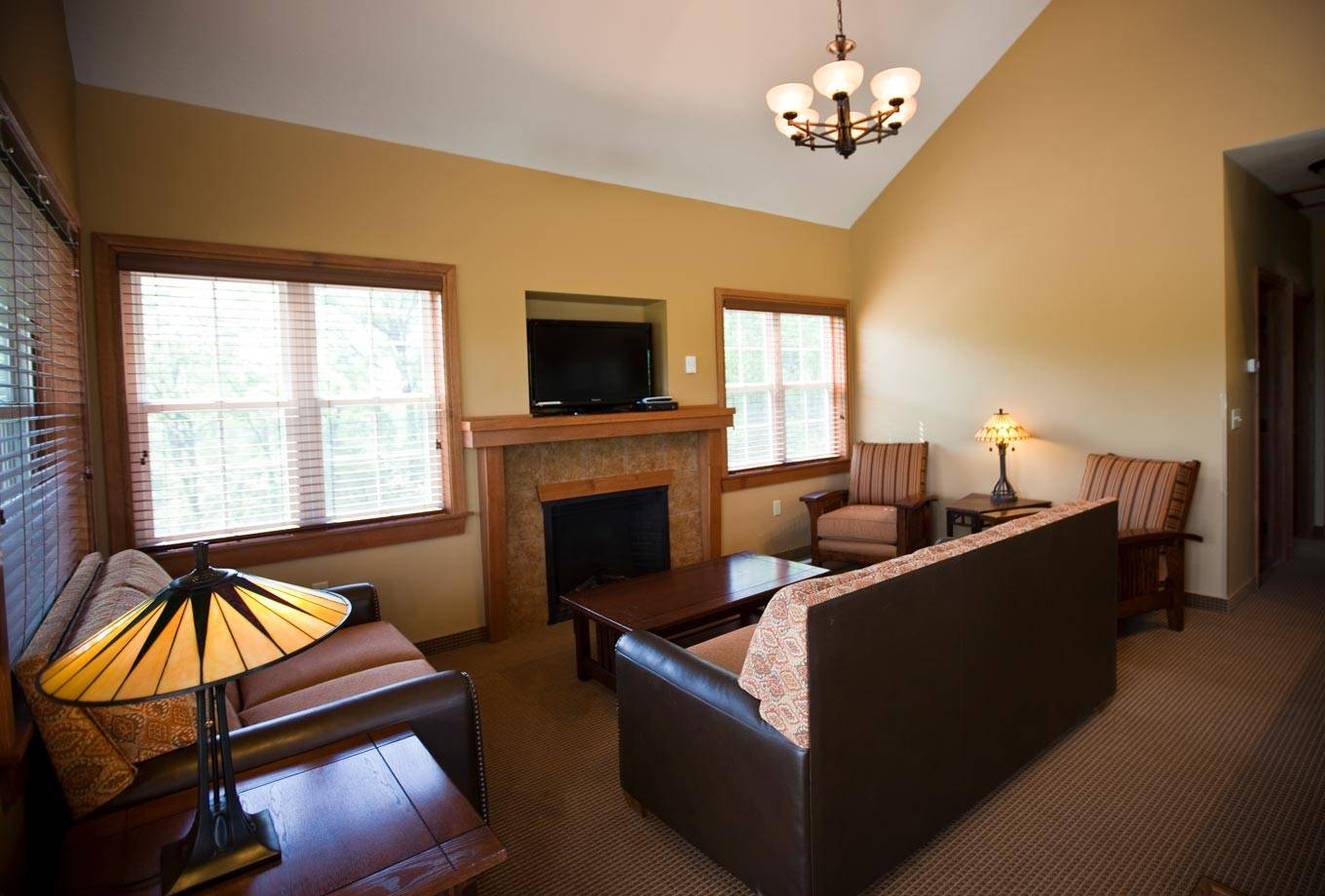 Comfortable Interior Of A Cottage At Honey Creek Resort With Fireplace