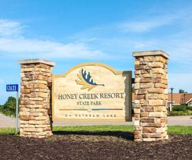 The entrance sign at Honey Creek Resort welcomes you