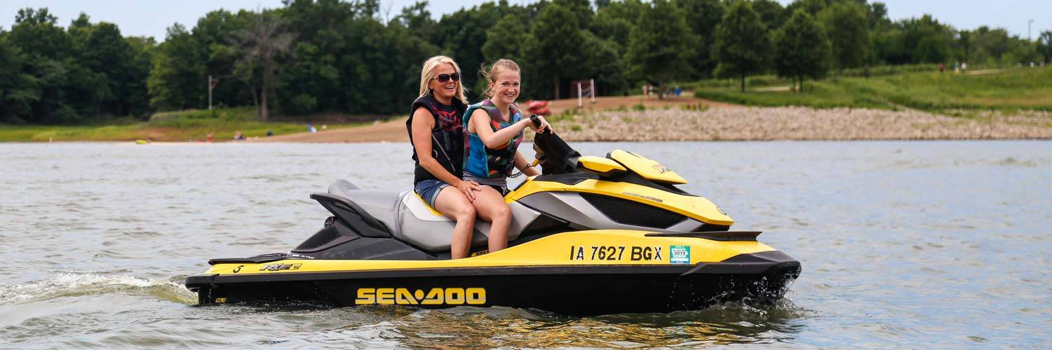 Guests enjoy a jet ski rental from Honey Creek Resort on Rathbun Lake