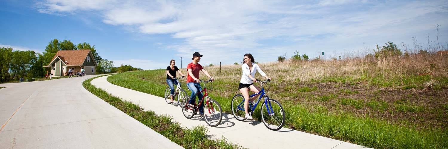 Guests enjoy biking on a trail at Honey Creek Resort on rental bicycles