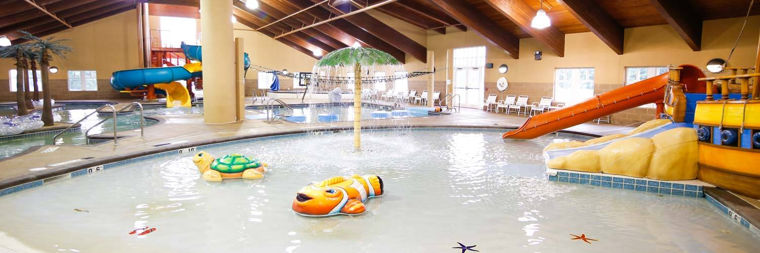 Fun indoor water park play at Buccanneer Bay in Honey Creek Resort