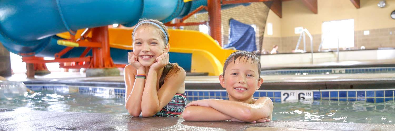 Two kids at Buccaneer Bay, Honey Creek Resort's indoor water park 1.5 hours from Des Moines, Iowa