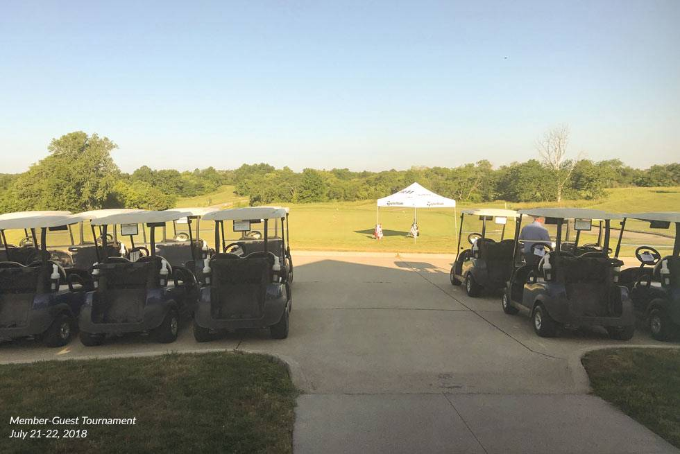 View of golf carts and a tent at The Preserve on Rathbun Lake during the 2018 Member-Guest Tournament