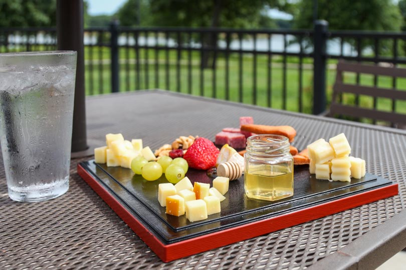 A delicious cheese platter is served outside Rathbun Lakeshore Grille at Honey Creek Resort