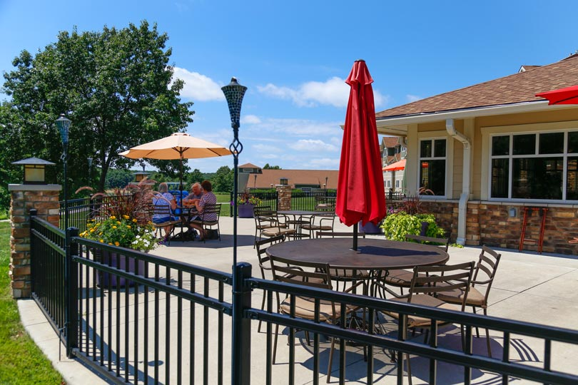Guests enjoy outdoor dining at Rathbun Lakeshore Grille at Honey Creek Resort