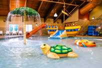 Buccanneer Bay, Honey Creek Resort's indoor water park, features fun water slides and various attractions