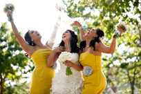 Bride and bridesmaids in a sunny yellow-themed wedding at Honey Creek Resort