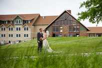 Bride and groom enjoy a quiet moment during their wedding with Honey Creek Resort in the background