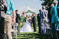 Wedding ceremony on the lawn at Honey Creek Resort