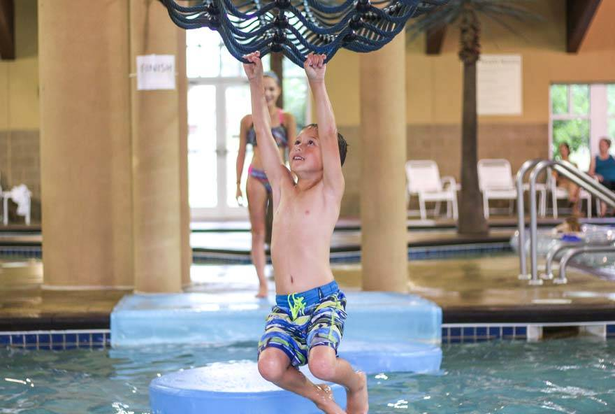 A kid plays at Buccaneer Bay, Honey Creek Resort's indoor water park