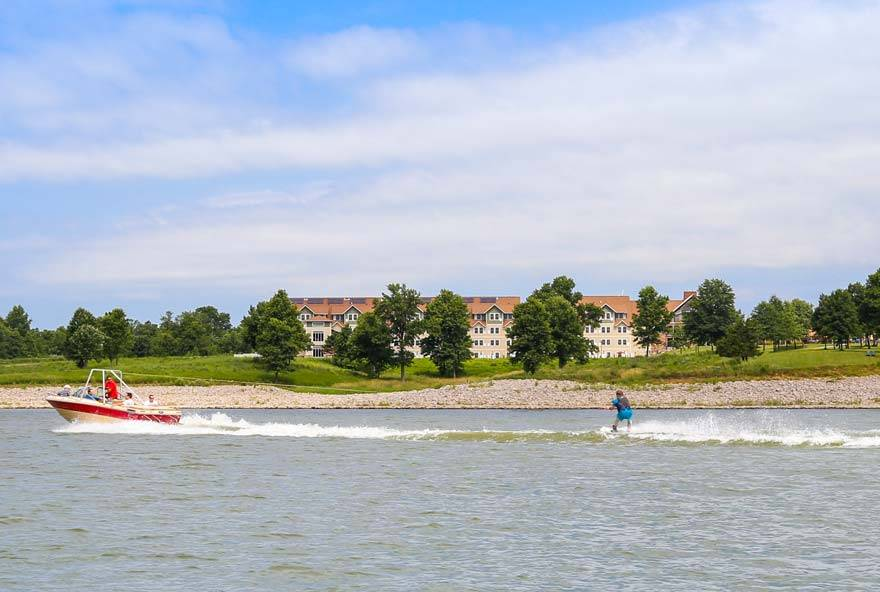 Waterskiing on Rathbun Lake with Honey Creek Resort in the background