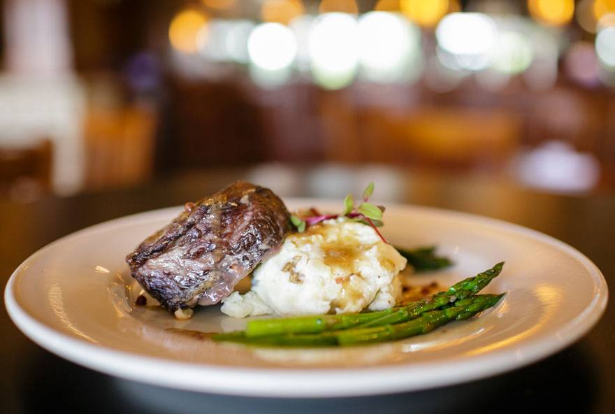 Beef short ribs are served with mashed potatoes and asparagus at Honey Creek Resort