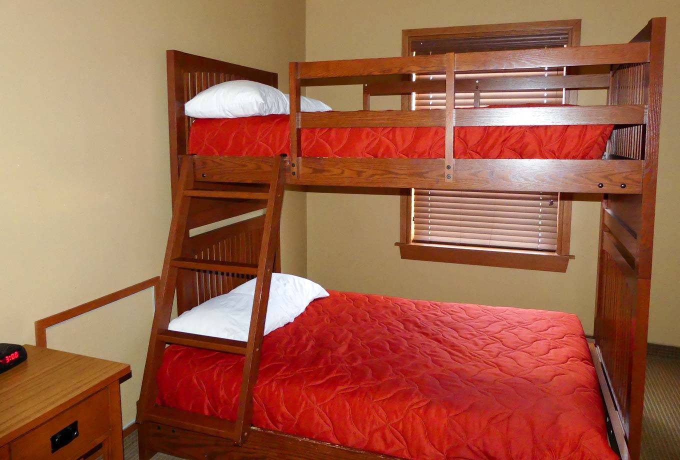 View of twin-over-full bunk bed in second bedroom of a two-bedroom cottage at Honey Creek Resort