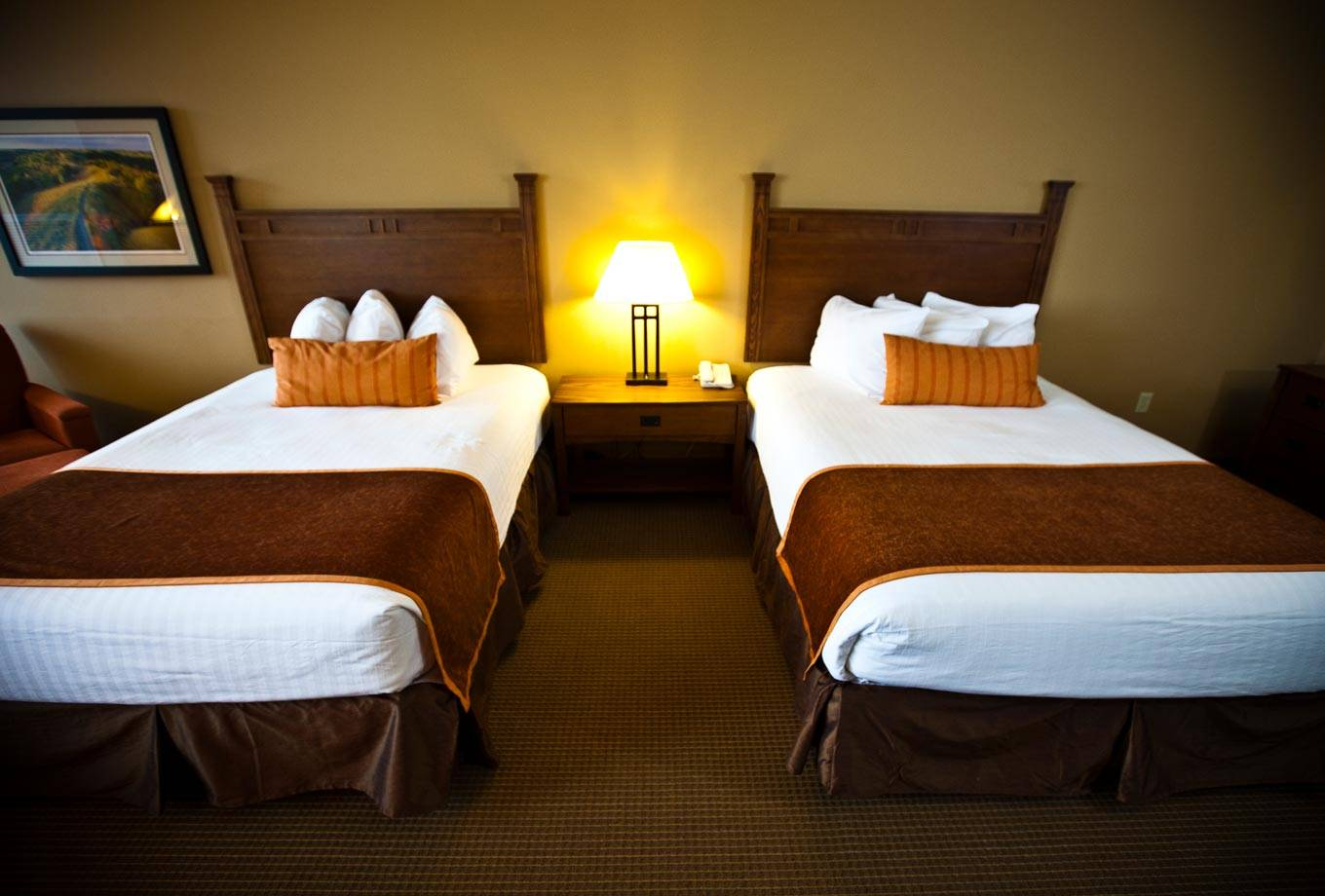 Two queen-size beds are featured in guest rooms at Honey Creek Resort's the Lodge on Rathbun Lake