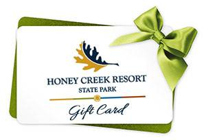 A green and white gift card is shown with Honey Creek Resort's logo