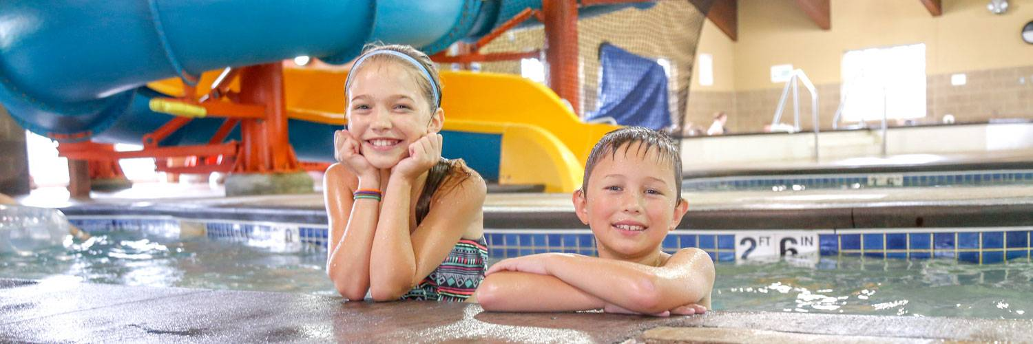 Brother and sister enjoying the Honey Creek Resort indoor pool and water park