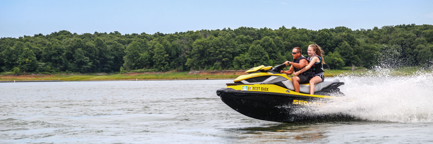 Jetskiers speed across Rathbun Lake at Honey Creek Resort