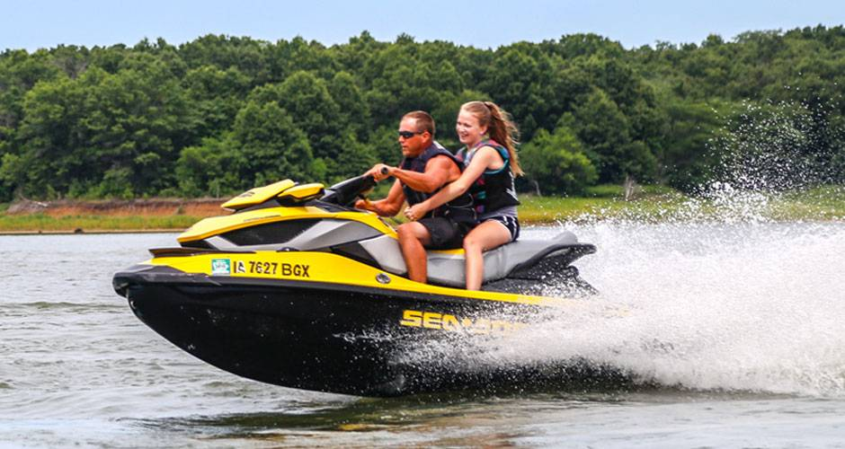 Father and daughter on a jet ski in a lake