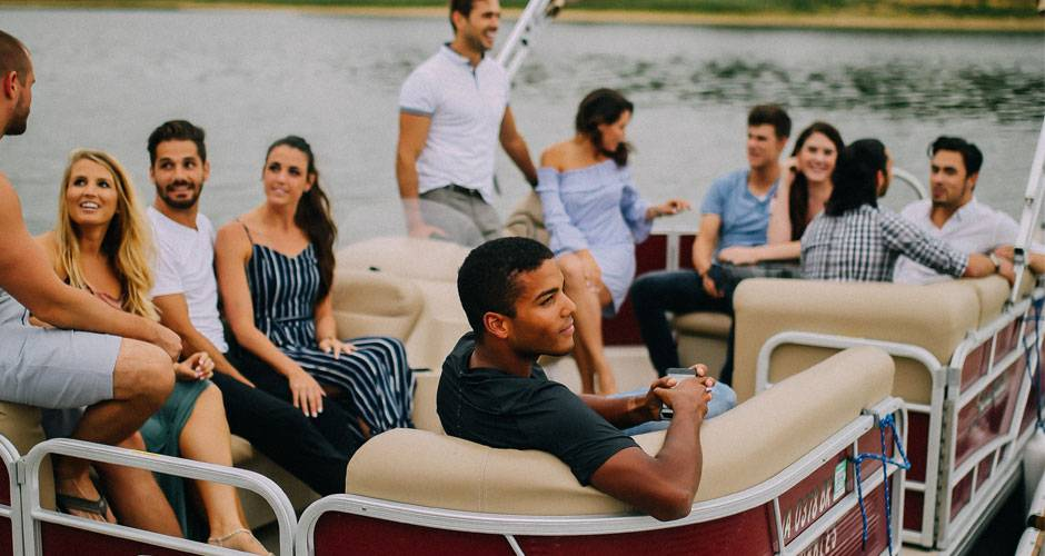 Group of young adults on a pontoon boat